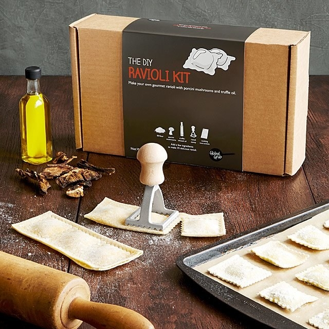 The DIY ravioli kit styled on a table with the tools and freshly made ravioli
