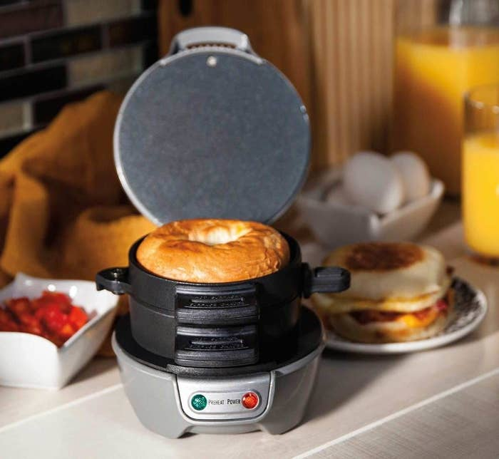 """Promising review: """"I bought this as a white elephant gift, but my son ended up with it at the end of the game so it came home with us. I'm surprised at how convenient this little sandwich maker is. I was really worried about cracking an egg into it, but the plate is so hot, there is no spill-over. As someone who tends to skip breakfast, this is a great way to make something quick with a good amount of protein. My favorite combination so far is an English muffin, pre-cooked sausage patty, cheddar, egg, and spinach leaves. Not only do all the ingredients come together nicely, but the muffin gets nice and crispy on the outside. Clean up is easy since the stacking segments come out so everything can be wiped down."""" —Leona DeleneGet it from Amazon for $18.99 (available in three colors)."""