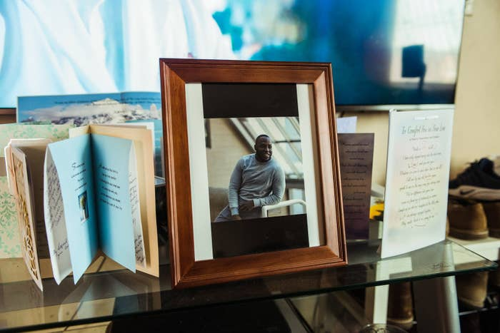 Condolence cards and a photo of Quam Ahmodu at his father's home, in Flatlands, Brooklyn. Ahmodu died at the home while in NYPD custody in October 2018.