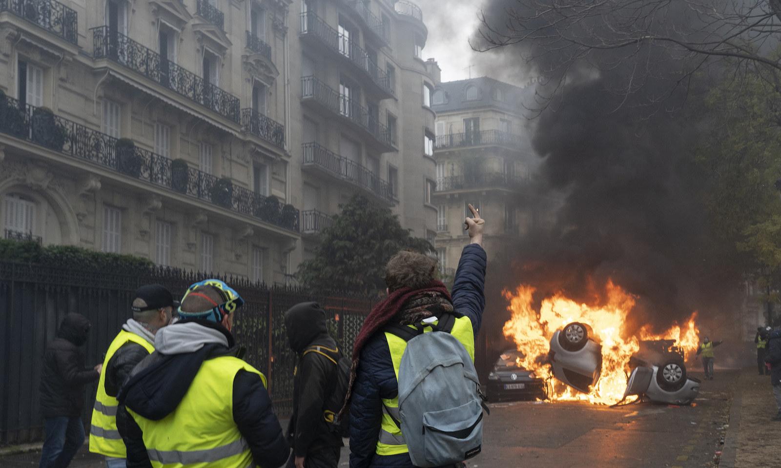 Cars on fire near the Arc de Triomphe in Paris.