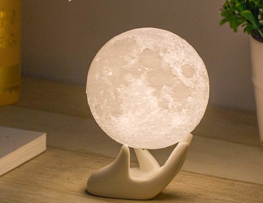 the small globe light that does look like the moon, balanced on the included stand