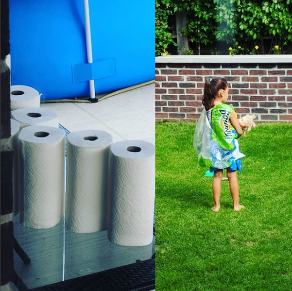 This kid, who took all the paper towel rolls out of the plastic and then wrapped herself in it