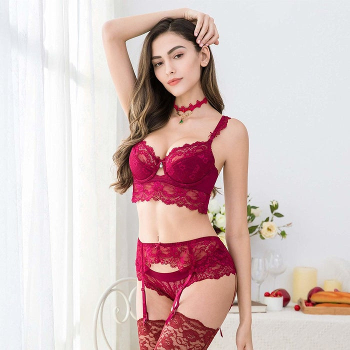 """Promising review: """"Okay I was a tiny bit scared to buy this, because I am curvy, but I was soooo wrong! It fits my figure so nicely! The bra and garter belt have adjustable straps that you can adjust to your liking and the material is so nice! Totally worth the price, I love it so much! This is my first lingerie set and I've never felt sexier. I thought the undies were going to be too small, but they were perfect!"""" —Jammie GutierrezGet the lingerie set from Amazon for $29.99+ (available in sizes 34B-40D and two colors)"""