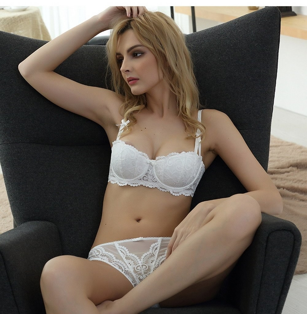 a model in the bra and underwear in white lace