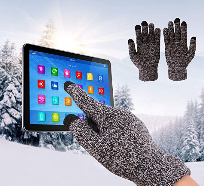hand wearing glove touching a screen