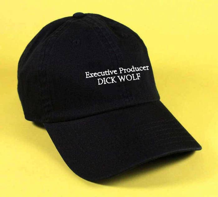 The black hat with words Executive Producer Dick Wolf in white lettering