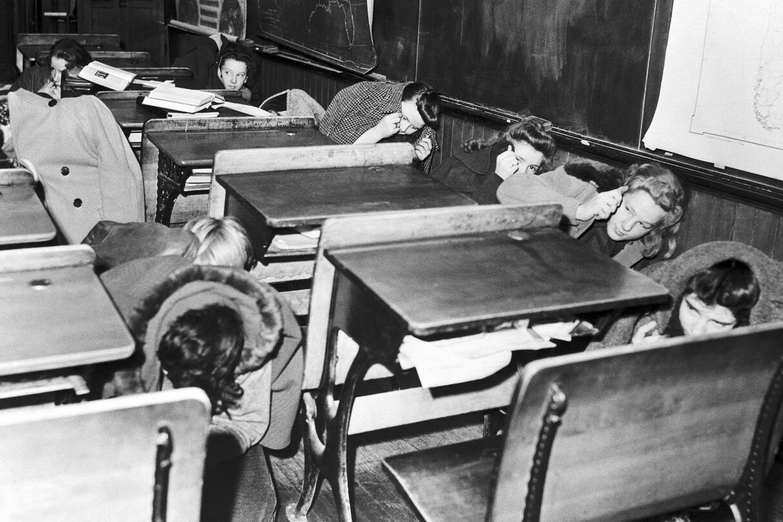 Schoolkids practice an air raid drill at an undisclosed location on Dec. 14, 1941.
