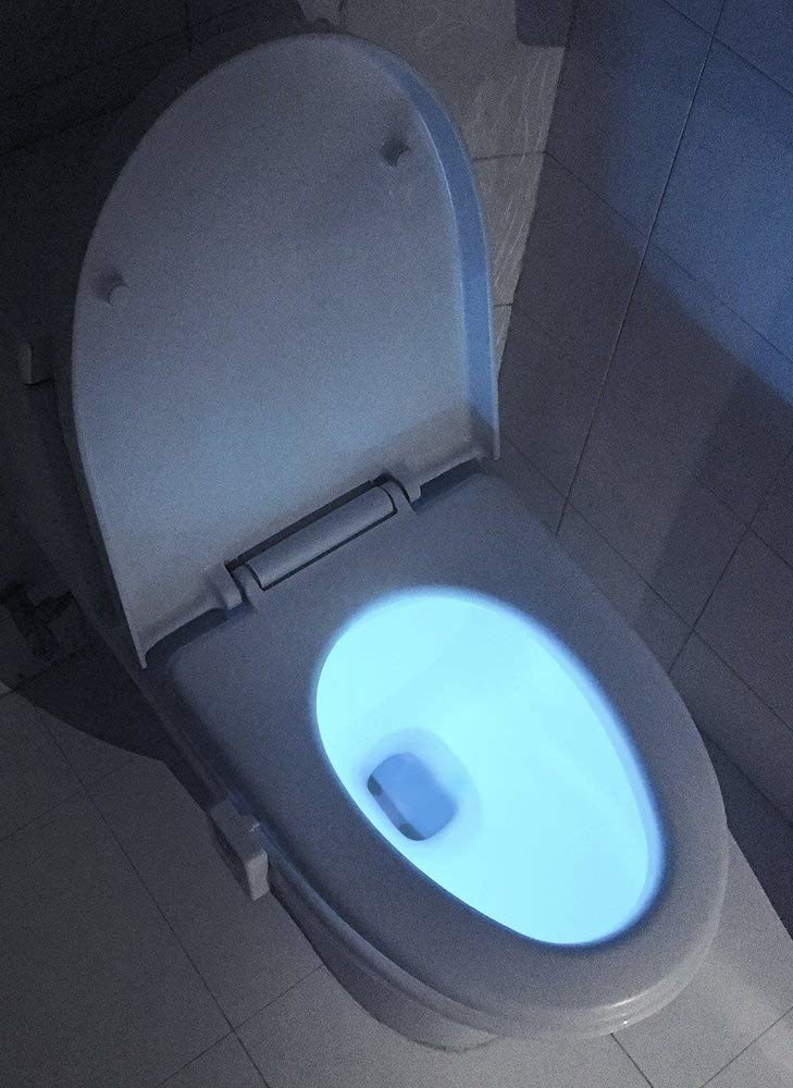 A toilet glowing blue