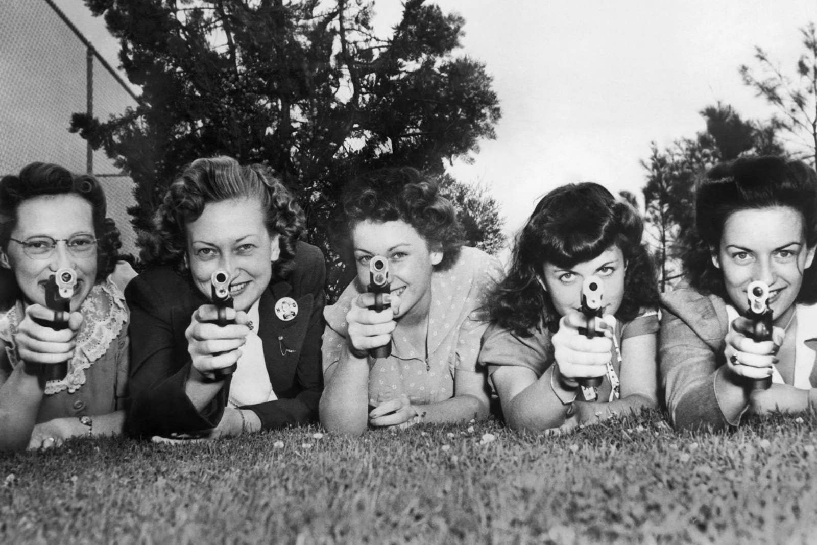 Civilian employees at McClellan Air Force Base engage in firearms training to be able to fill in for some of the men called off to war, in Sacramento on July 18, 1942.