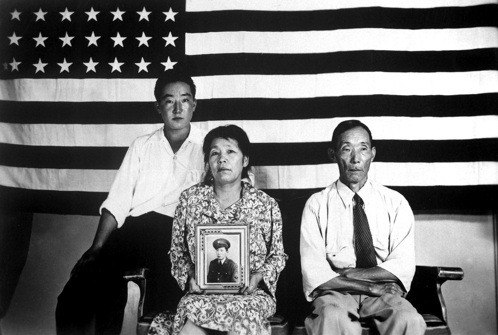Portrait of the Hirano family, George (left), Hisa, and Yasbei, at the Poston Internment Camp, in Poston, Arizona.