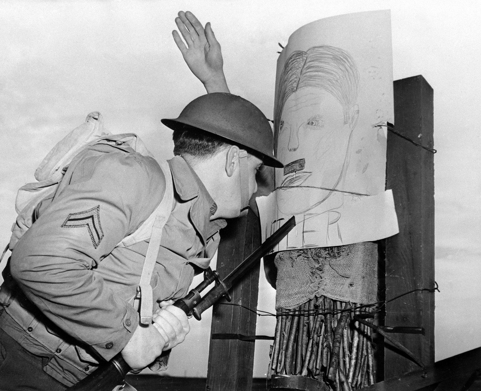 A soldier trains with his bayonet on a dummy resembling Adolf Hitler on Dec. 19, 1941.
