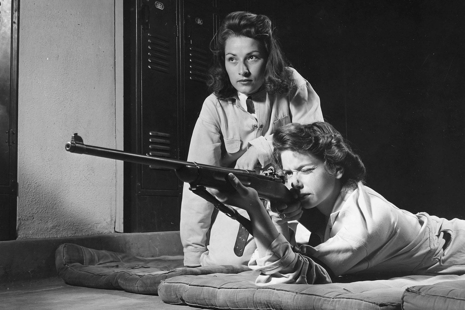High school girls practice marksmanship at Roosevelt High School in Los Angeles as part of the school's Victory Corps, a program designed to train students for combat, 1942.