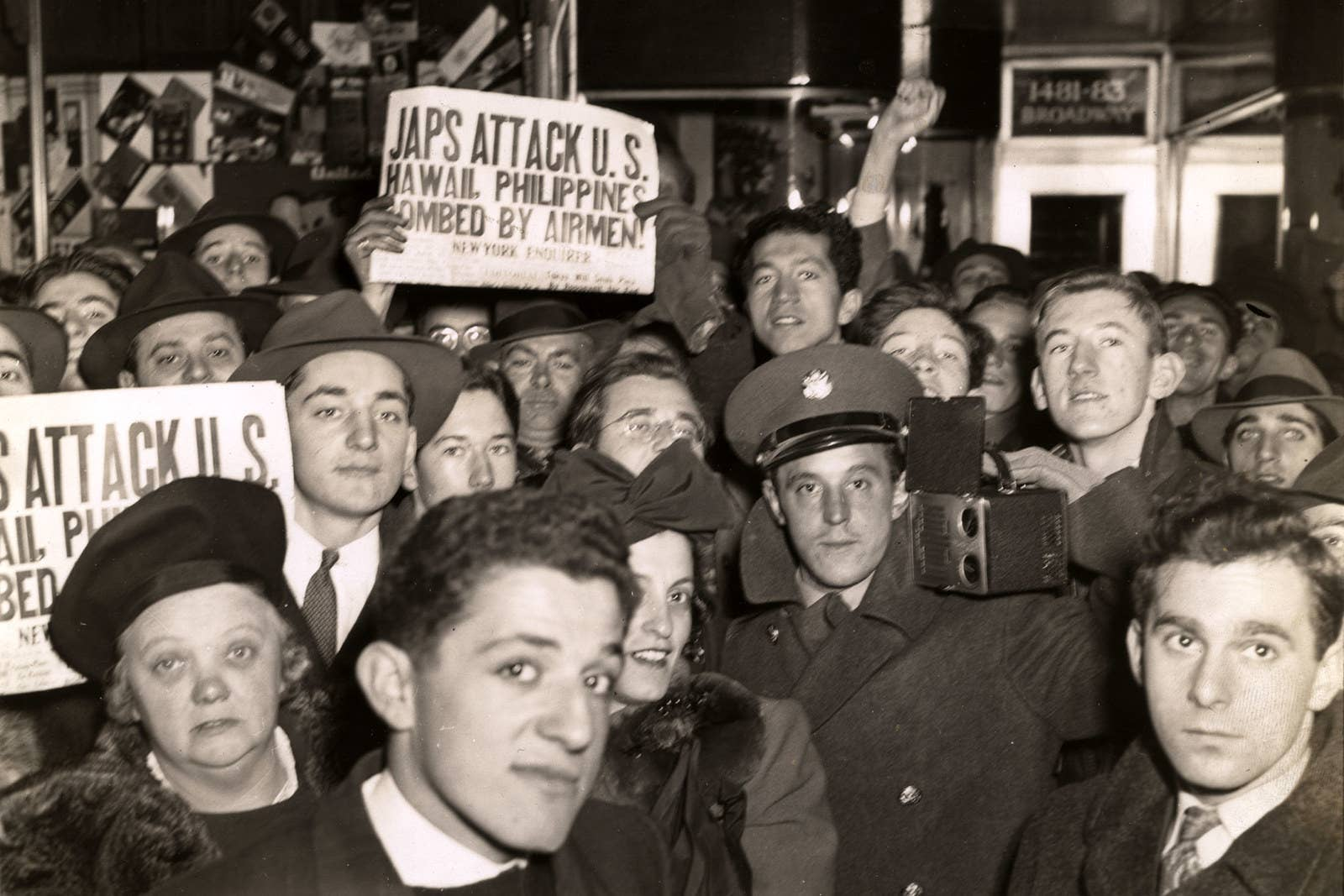 A crowd on Broadway in New York City holds up newspapers announcing the Japanese attack on Pearl Harbor on Dec. 7, 1941.
