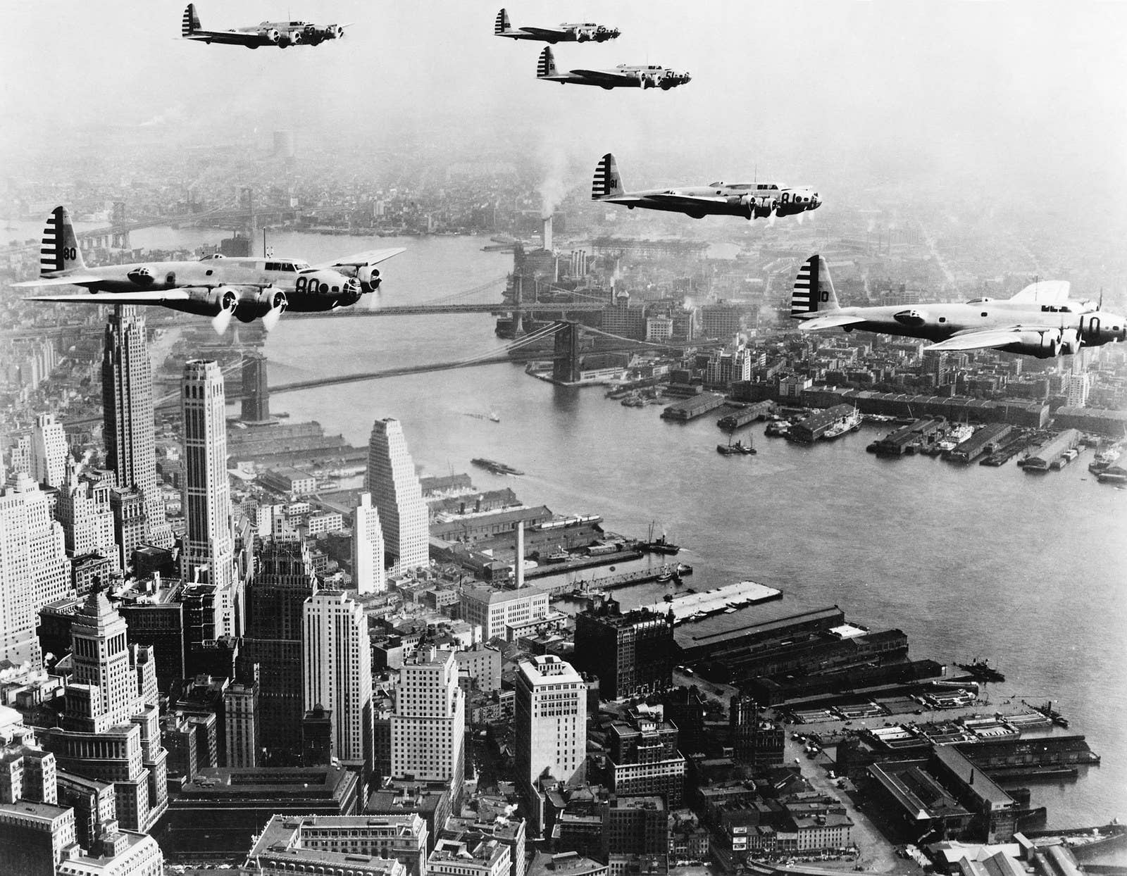 US Army Boeing B-17 airplanes fly in a precise pattern over New York City, 1941.
