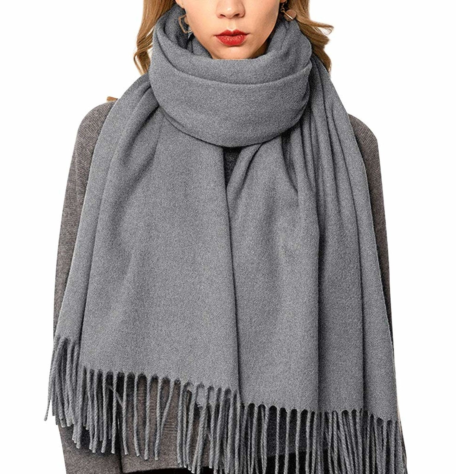 "Promising review: ""Extremely impressed with the high quality and great price of this scarf. It DOES NOT look cheap. I own an Acne Studios wool scarf ($260) and would say while this one is a bit lighter weight (still super warm and cozy) it is comparable in style, color, and quality to my Acne scarf. I would definitely buy again — both for myself and as a gift."" —NatalieGet it from Amazon for $16.98 (available in 12 colors)."
