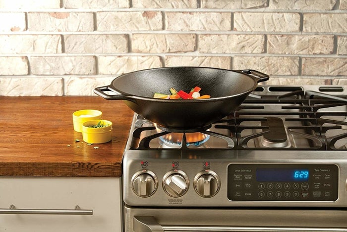 """Promising review: """"This wok is fantastic. The wok came pre-seasoned as advertised. There were no flaws that we could see, and the inside surface was smooth. The wok is heavy and flat on the bottom, so it won't move around on the stove when cooking. In our opinion, this makes it safer than other pans. Just as everyone said, it is round on the inside and deep. We use a gas range, so there is no issue getting the wok to heat up and in a hurry, and when it gets hot, it stays hot for a long time."""" —RichGet it from Amazon for $49.90."""