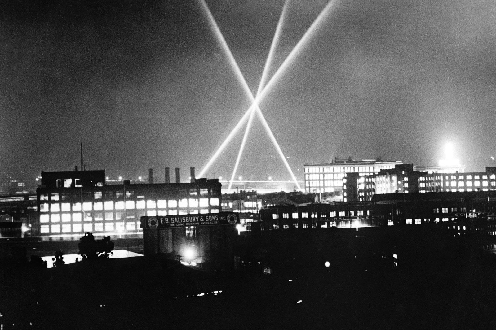 Anti-aircraft searchlights undergo a test in the sky above the General Electric Company at Schenectady, New York, on Dec. 19, 1941.
