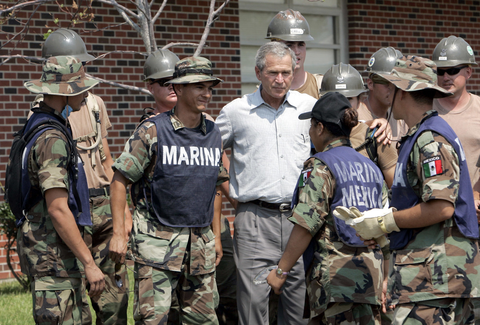 President George W. Bush talks with Mexican marines helping to clear debris in Gulfport, Mississippi, in 2005.