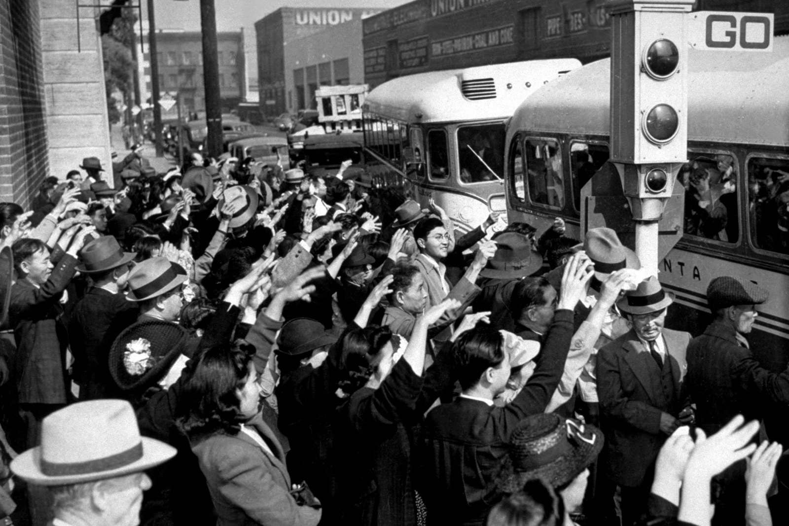 Hundreds of Japanese in Los Angeles board buses for San Francisco where they will sail back to Japan, circa 1941.