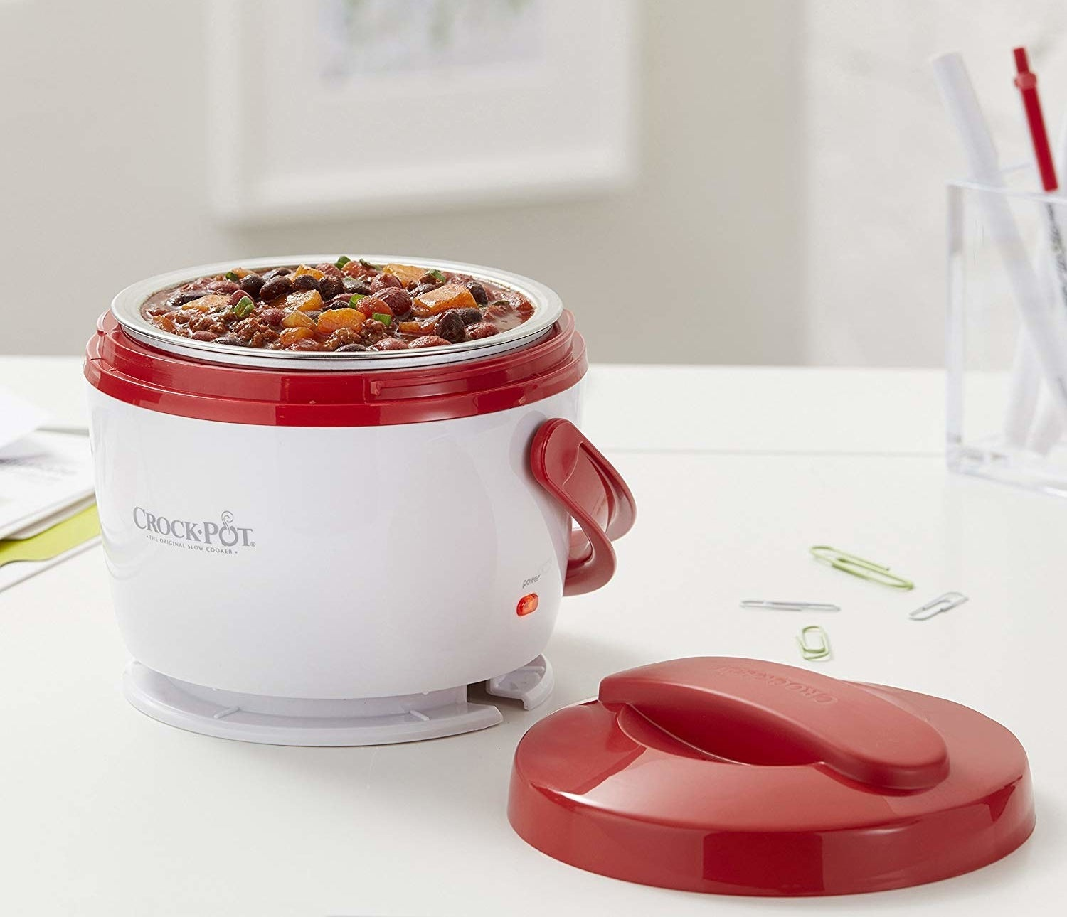 A mini Crock-Pot filled with food