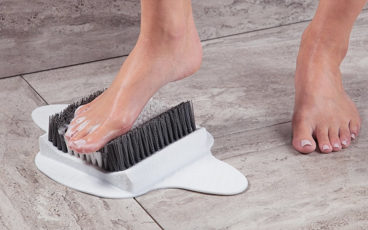 Model using the foot scrubber