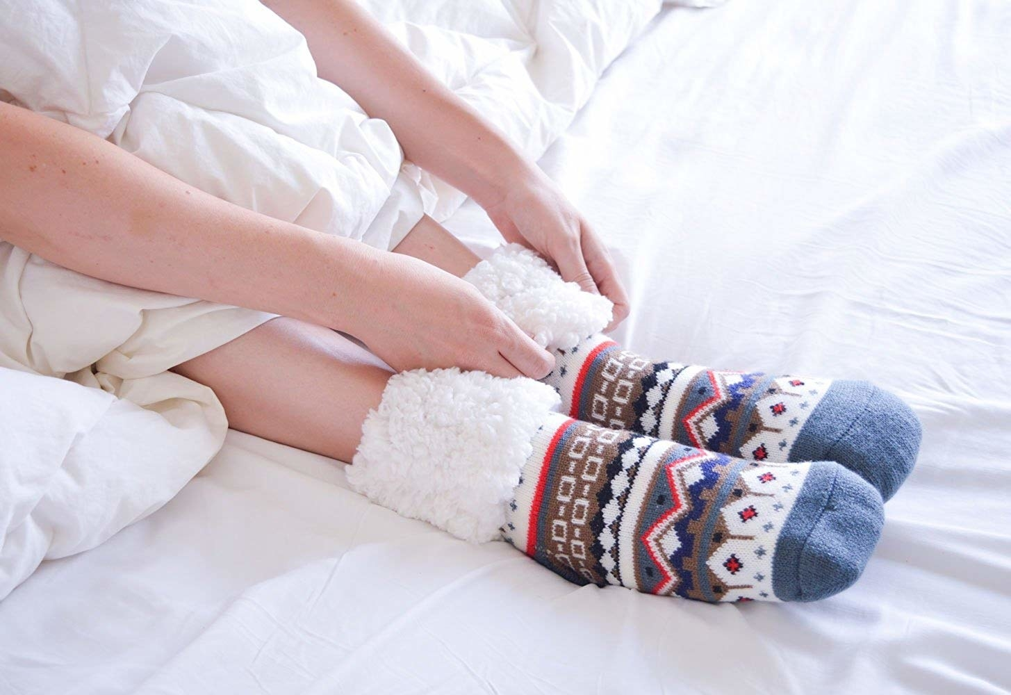 Model in the fair isle slippers with the tops cuffed to show the sherpa lining