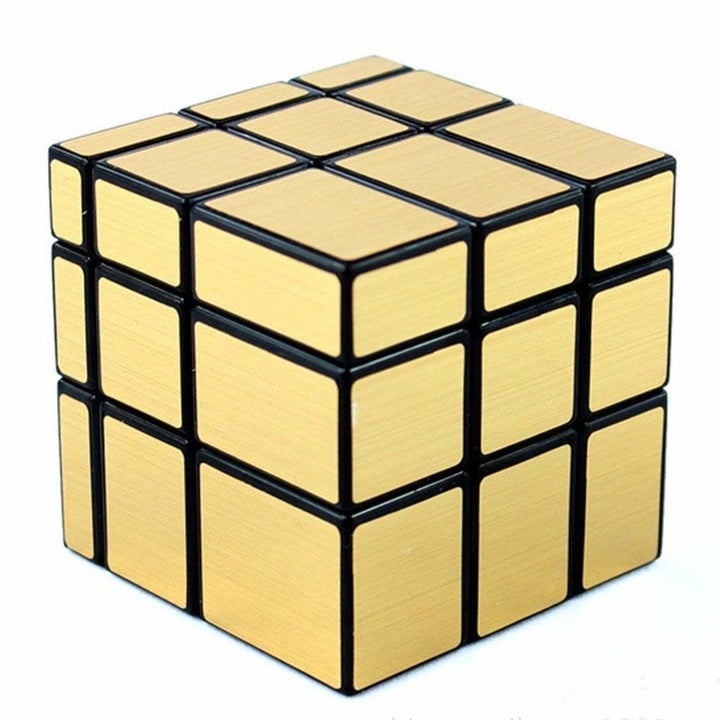 Looks like a Rubick's Cube, but all gold; instead of the colors it's cut so each 3-square row is slightly different widths and heights