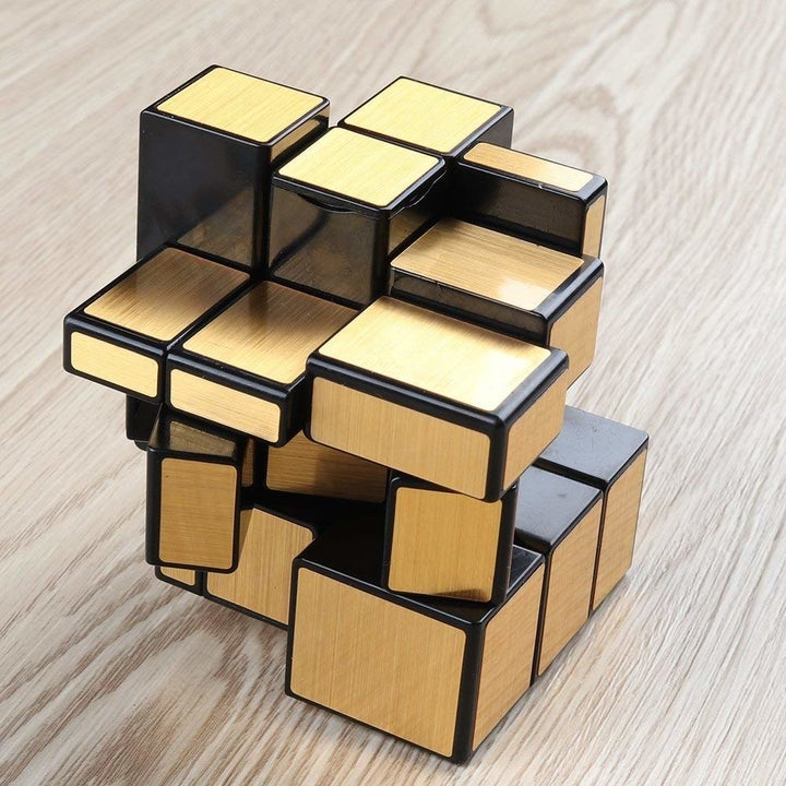The cube mixed up; because of the slightly different sizes, it looks like a jumble of different sized rectangular prisms