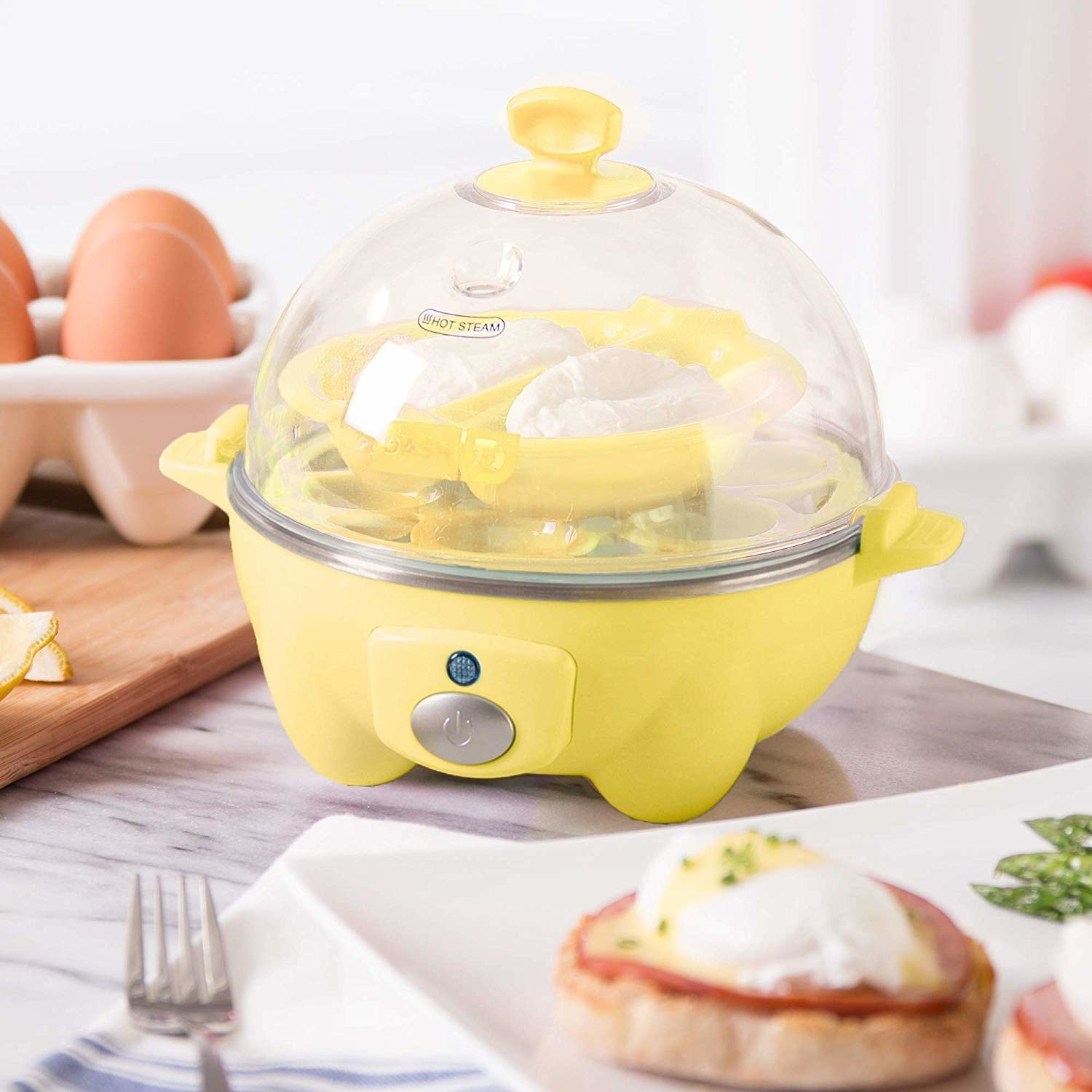 the yellow egg cooker with it poaching eggs inside