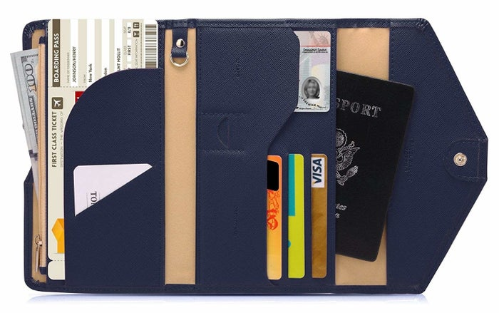 """Promising review: """"This is my new go-to travel wallet! It has slots for everything you need. The color is great and it's not bulky. If it had more than three credit card slots I would use it as my everyday wallet because that's how much I love it. The inside flap came in handy for my plane boarding passes."""" —TeeGet it on Amazon for $14.99 (available in 23 colors)."""