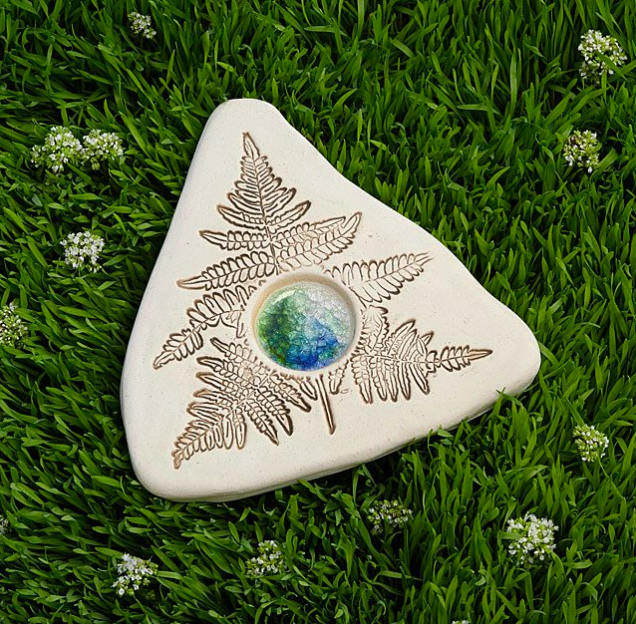 triangle shape stone with leaf pattern engraved with water collection part in the middle