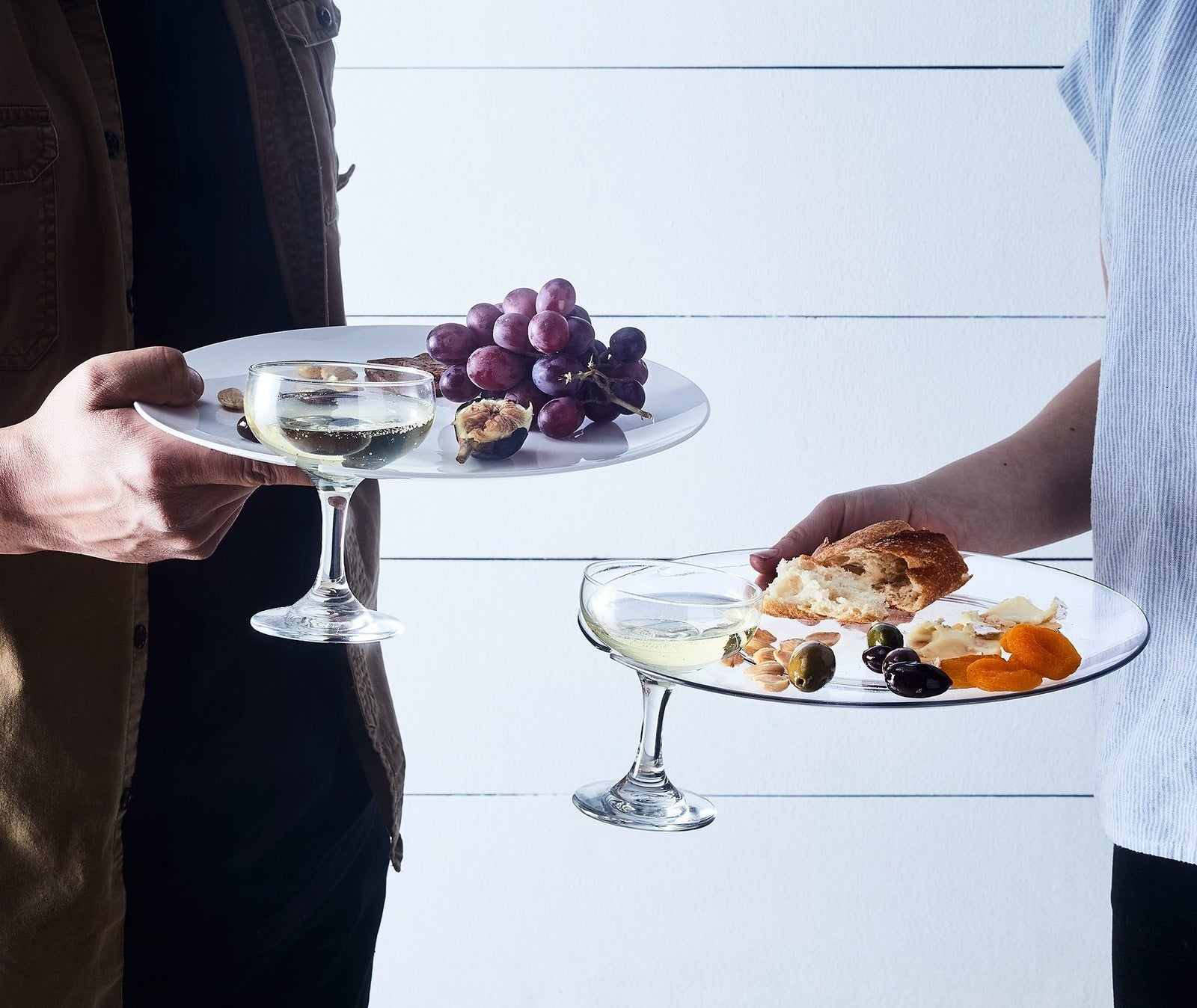 Models holding plates with groove for holding wine glass