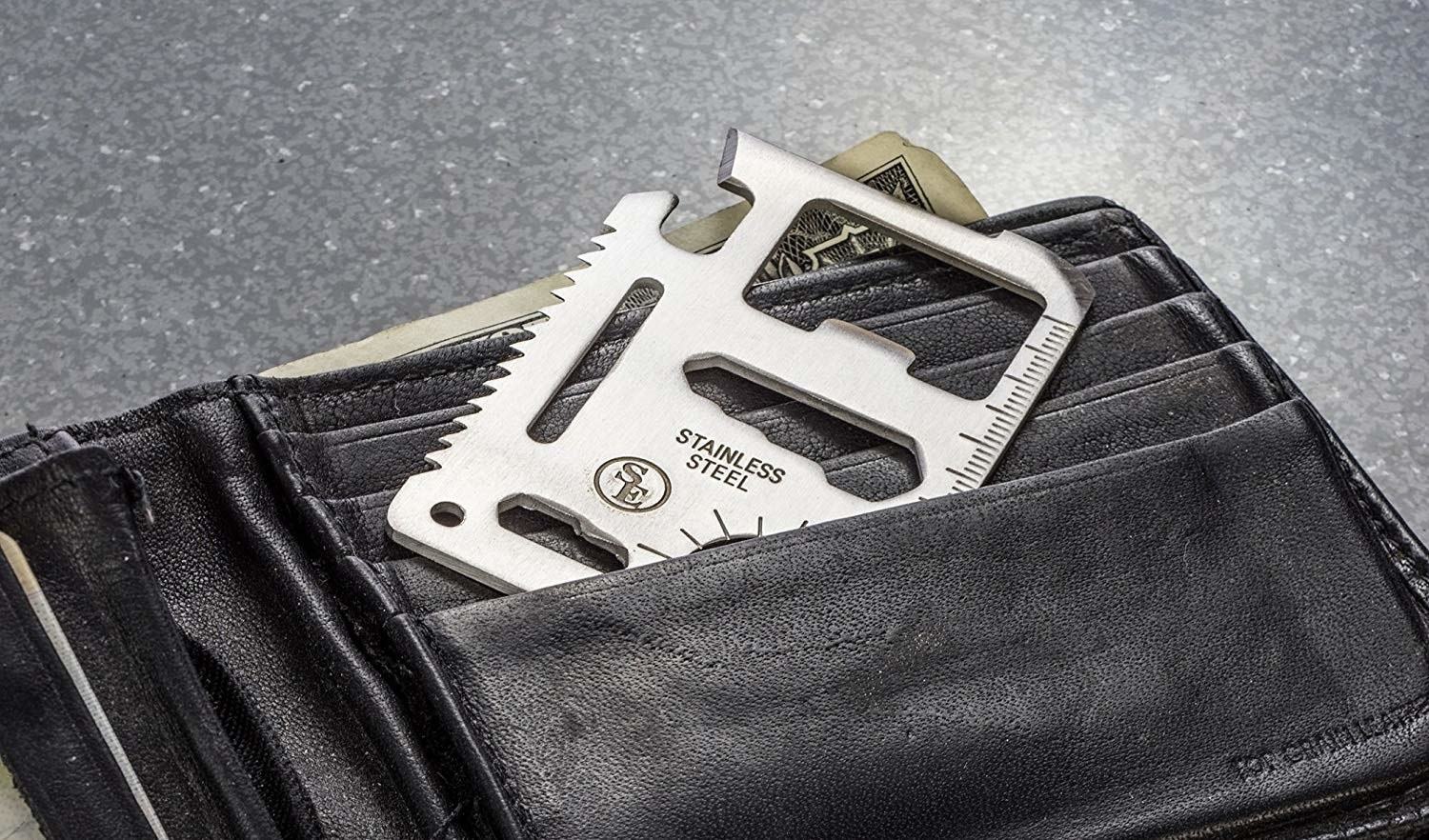 the credit card shape multitool in a wallet pocket