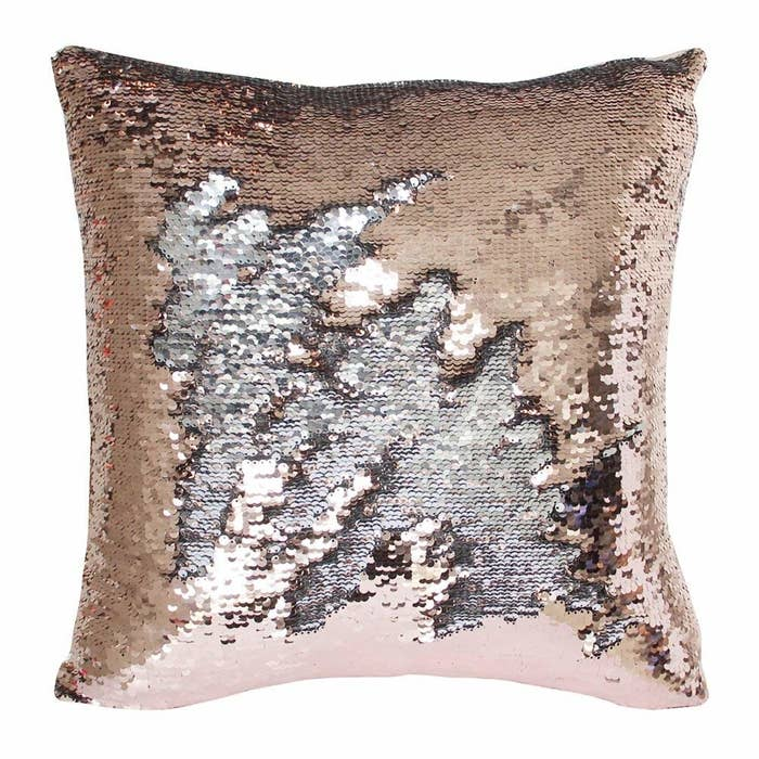 The gold pillow with a patch of sequins flipped to turn silver