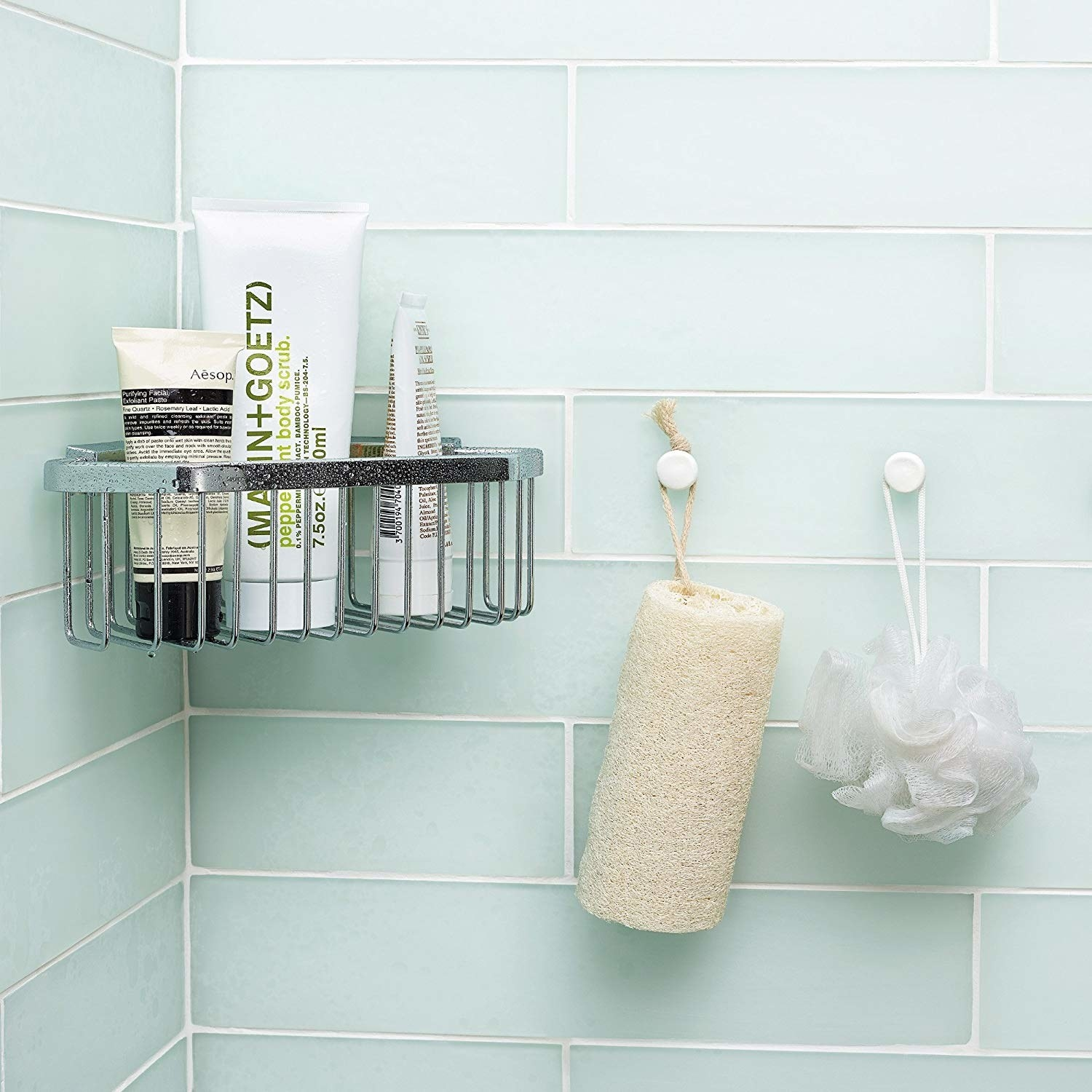 bathroom tile surround with caddy mounted on wall with the moldable glue