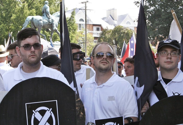 James Alex Fields Jr. (left) holds a black shield in Charlottesville during a white supremacist rally on Aug. 12, 2017.