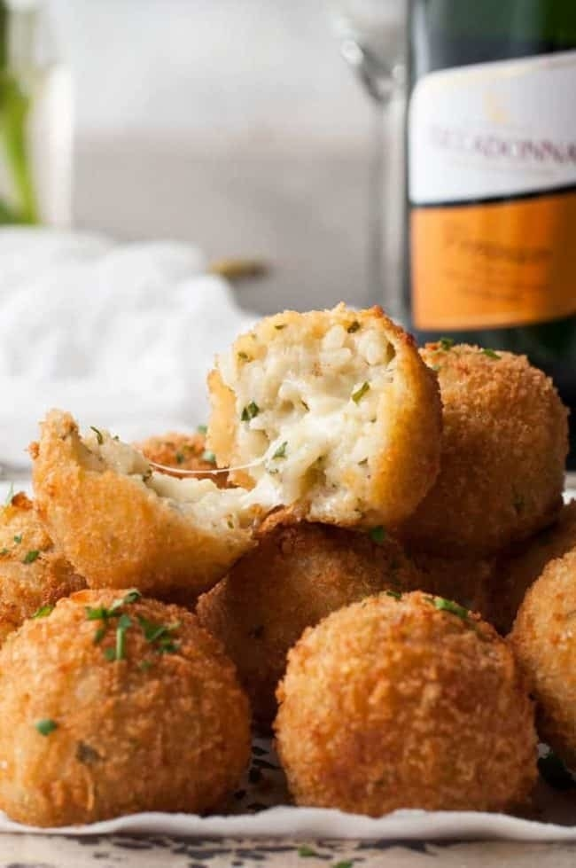 Although easy to make, these arancini balls take a bit of time. You first need to prepare a cooked risotto base that takes at least 30 minutes to make, then you need to let that cool. Once it's chilled, you just portion it into balls, bread and fry them, and enjoy. They're crisp on the outside, creamy on the inside, and the perfect snack for parties. Get the recipe.Pro tip: Make the cooked rice the night before and let it chill overnight. The colder the rice, the easier it'll be to form them into balls.