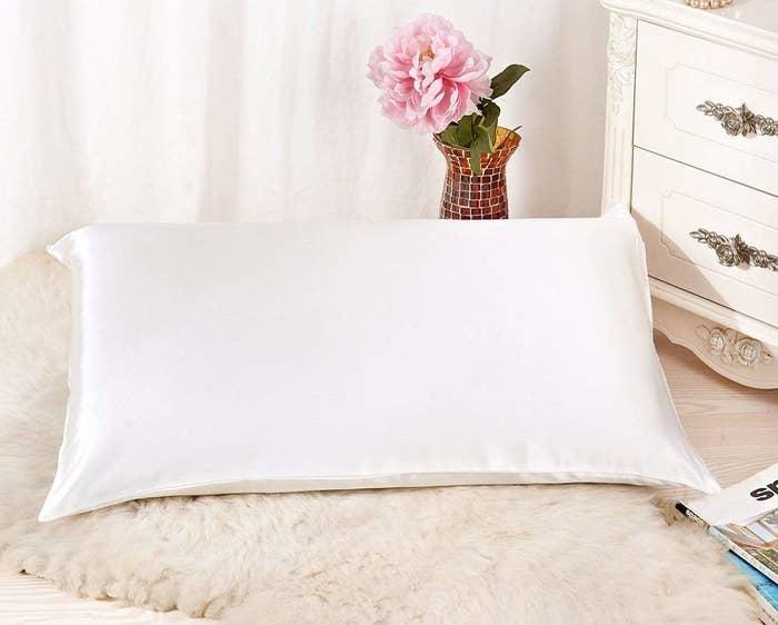The satin pillowcase on a standard size pillow