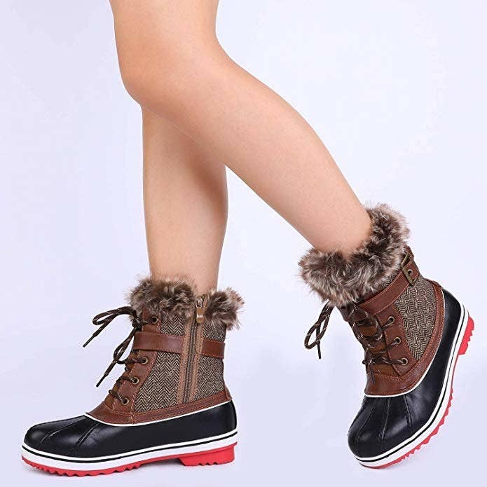 cc9c0e065732 Cozy mid-calf snow boots to keep you comfy the whole day through no matter  what the elements have in store.