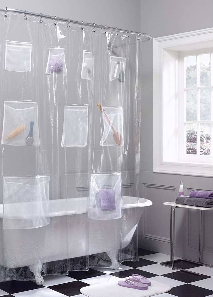 The curtain with brushes, towels, tubes, and more inside its pockets
