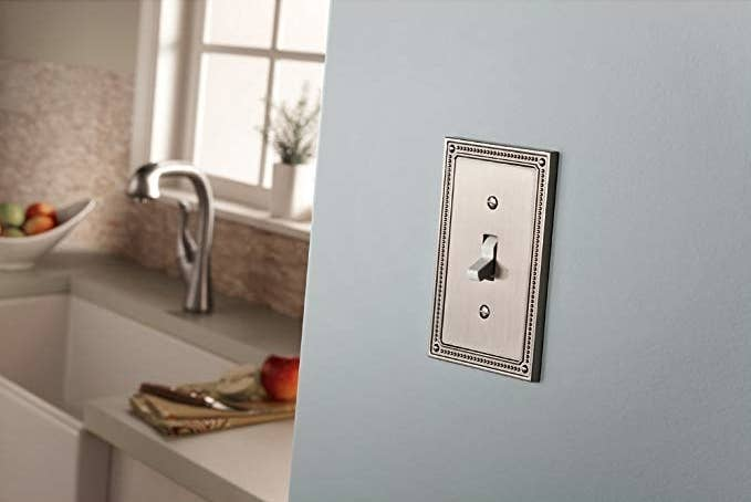 Franklin Brass outlet cover in a satin nickel color and detailed edge