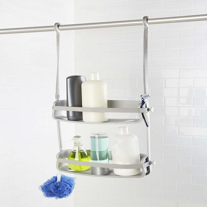 The caddy holding various tubes and hanging from the curtain rod