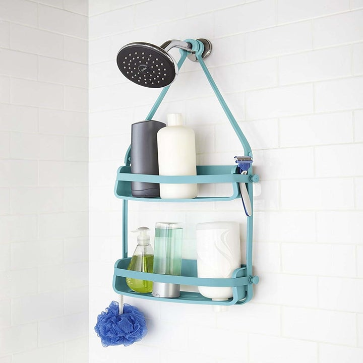 The caddy holding various tubes and hanging from the shower head