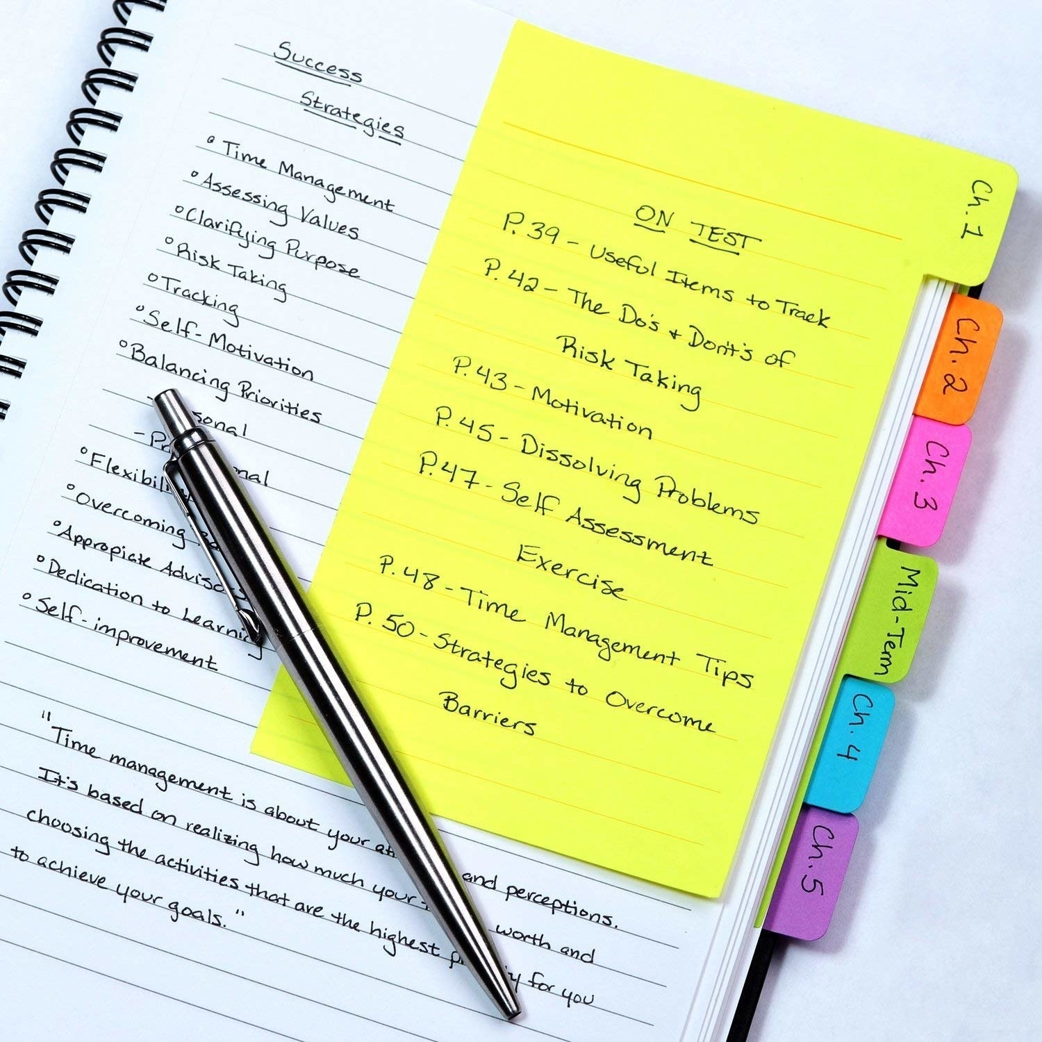 "The yellow, orange, pink, green, blue, and purple tabs being used to divide a notebook into study chapters. The one at the front has a list of notes labeled ""On Test"""