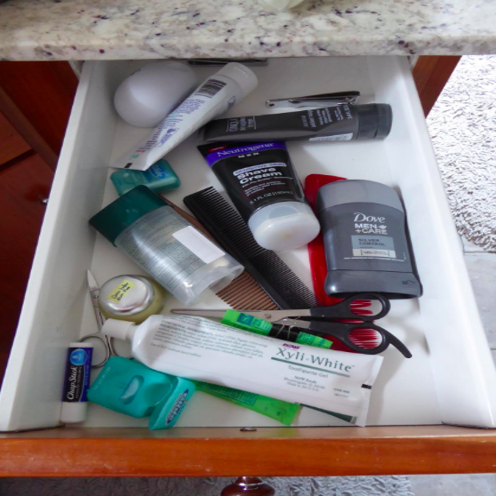 Messy drawer with toiletries