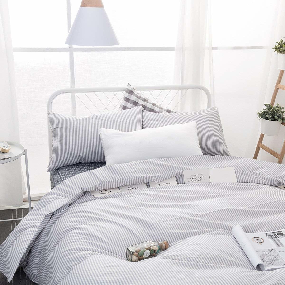 Light gray striped duvet on a bed