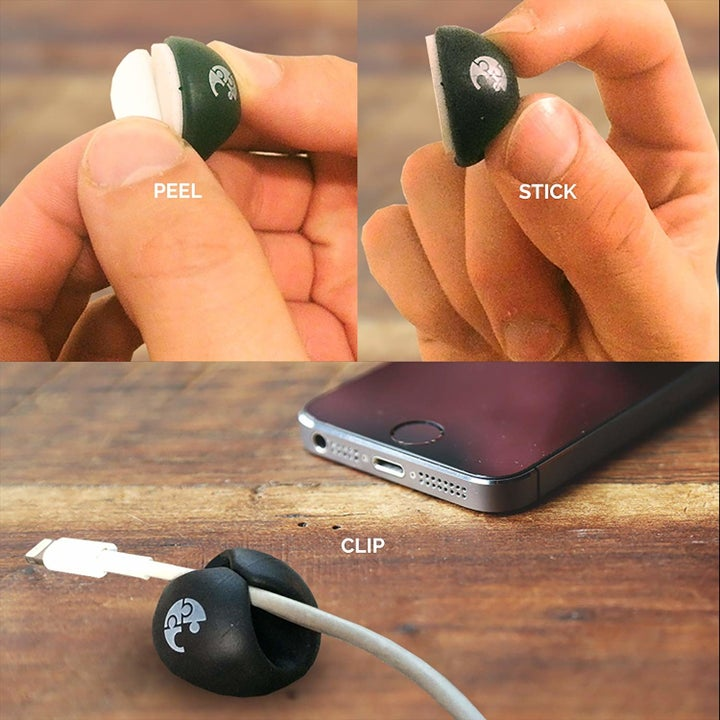 """A hand removing the backing on the thumbnail-sized, round cable holder with text """"peel."""" Then a hand holding the product with text """"stick."""" Finally, the product with an phone charging cable stuck inside with text """"clip"""""""