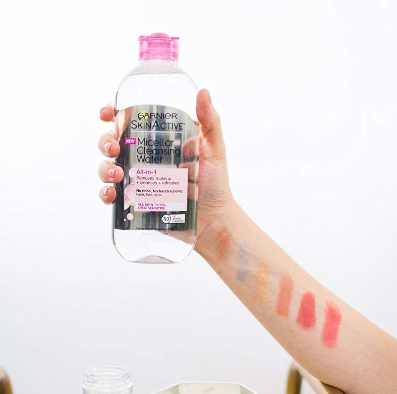 model holding bottle of micellar water