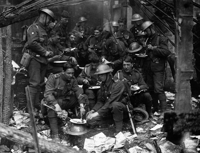 1921: Soldiers have a meal in the remains of the Custom House, Dublin (headquarters of the British Civil Service in Ireland), burned by the IRA during nationalist unrest.