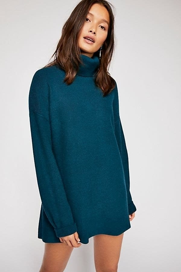 """Promising review: """"I truly love this sweater! The fabric is very soft and cozy. The fit is oversized, as pictured, but it's not crazy oversized. The fabric feels light and does not look bulky on. Compared to last year's Swim Too Deep pullover, this sweater is a similar silhouette but with less bulk, a silkier fabric, and not quite as oversized. I loved the Swim Too Deep sweater, but I love this one even more. Plus, the neutral colors are to die for!"""" —meow517Get it from Free People for $148 (available in sizes XS-L and in eight colors)."""